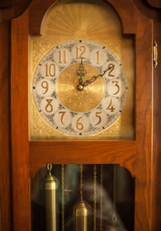 Lite wood Grandfather clock with a time of 12:10