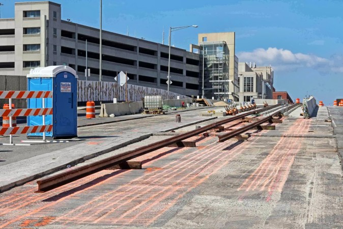 Passengers coming from Union Station will board the streetcar on an overpass outside of a parking bride. Image via Fulertography.