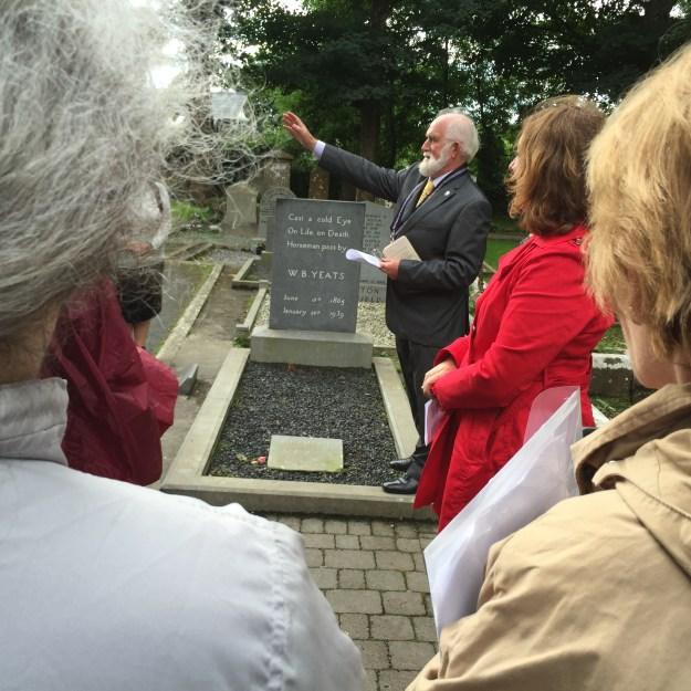 Summer School participants visit grave of Yeats in Drumcliff churchyard, at foot of Benbulbin mountain.