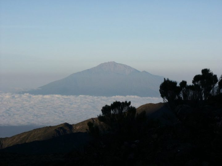Mount Meru, rising 60km away to the west, was a constant companion during my first ascent of Kilimanjaro