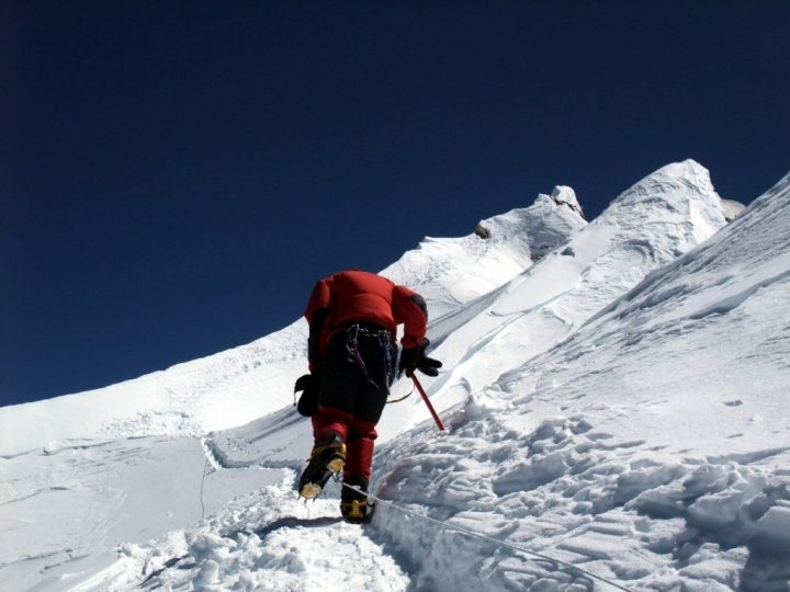 Anne-Mari on the summit crown, with the subsidiary summits on the right and true summit at the far end