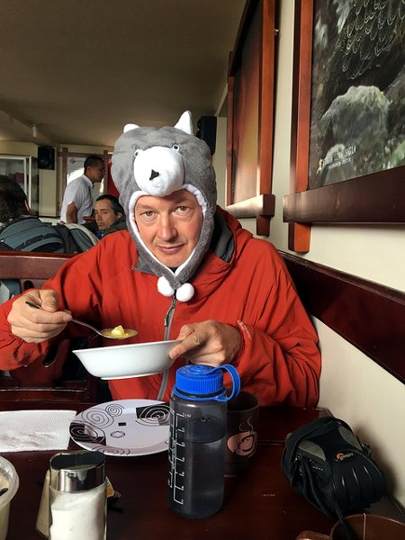 Me at the Carrel Hut deciding what headgear to wear for my summit ascent (Photo: Edita Nichols)