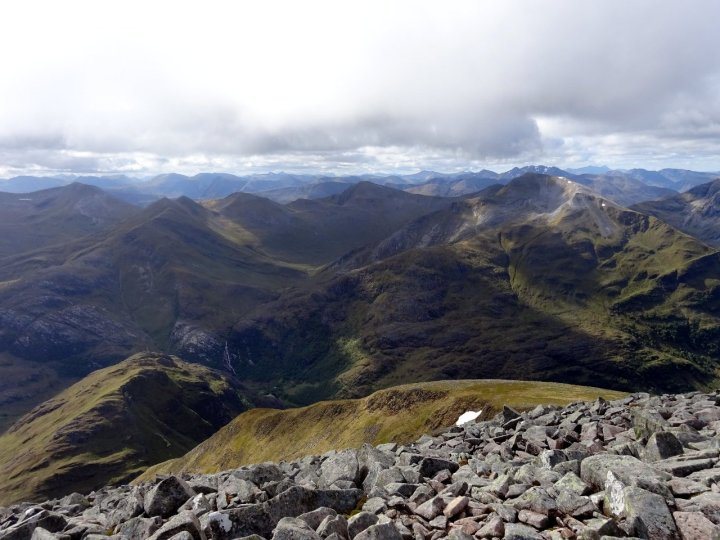 The Ring of Steall from the CMD Arete. Sgurr a Mhaim is the grey-topped peak towards the right, and the top of the waterfall can be seen below left.
