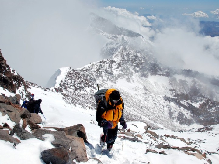 Me on Aconcagua's summit ridge, with the south summit behind