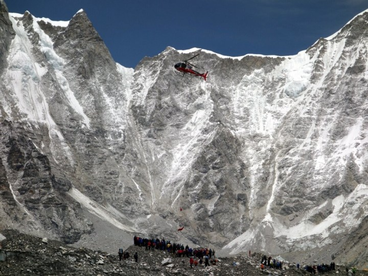 We see dramatic footage of the rescue, with bodies brought down by helicopters on long lines