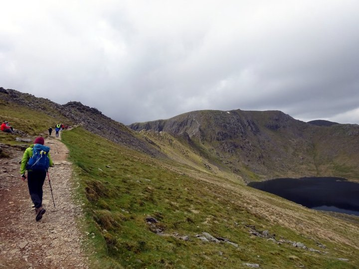 Approaching the crest of Striding Edge, with Helvellyn and Red Tarn to the right