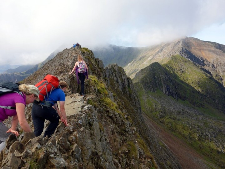 Scrambling along the knife edge crest of Crib Goch