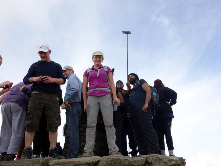 Edita battles hordes armed with selfie sticks for her summit photo