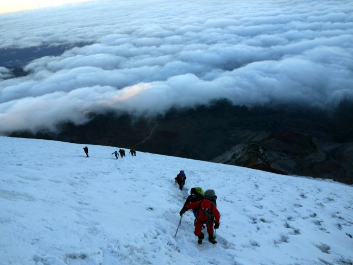 Ascending the Thielmann Glacier as dawn breaks