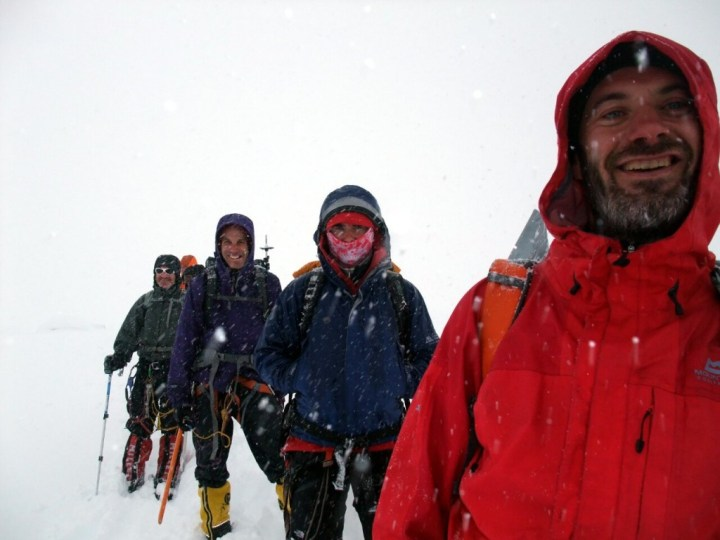 Robin, Steve, Karel and Mark descend in a blizzard
