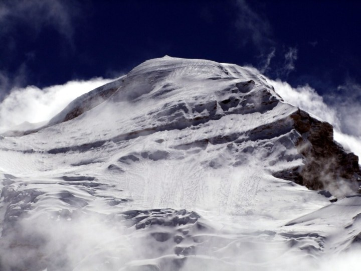 Cho Oyu from base camp this morning, showing avalanche debris on its western slopes