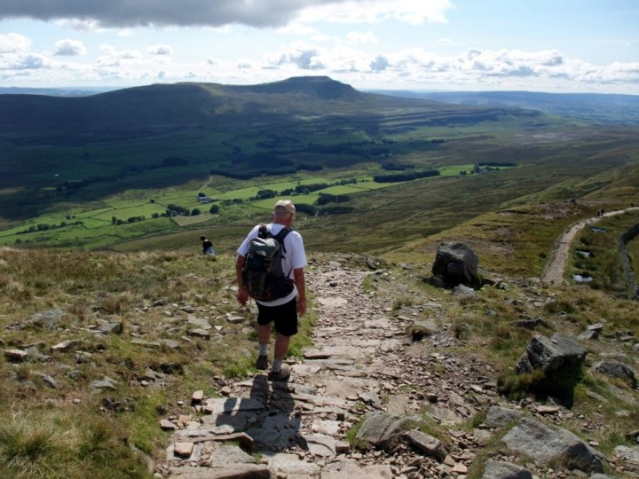 Ken descends from Whernside with Ingleborough up ahead