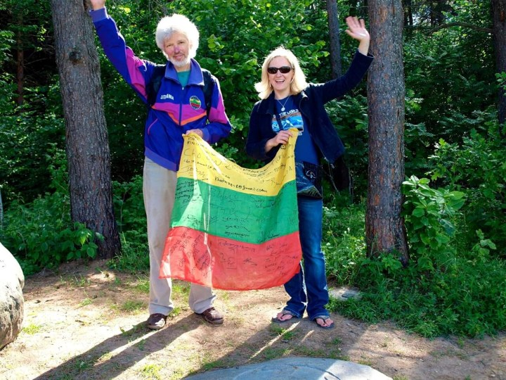 Vladas Vitkauskas, the first Lithuanian to climb Everest, holds the Lithuanian flag atop the summit Aukstojas Hill in 2013 with Edita Uksaite Nichols, the first Lithuanian woman to climb Everest (Photo: Edita Horrell)