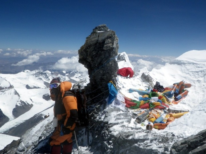 It will be very difficult to retrieve all of the debris that has built up on Everest over the years. These oxygen cylinders on the Northeast Ridge are in an extremely inaccessible position (Photo: Grant Rawlinson).