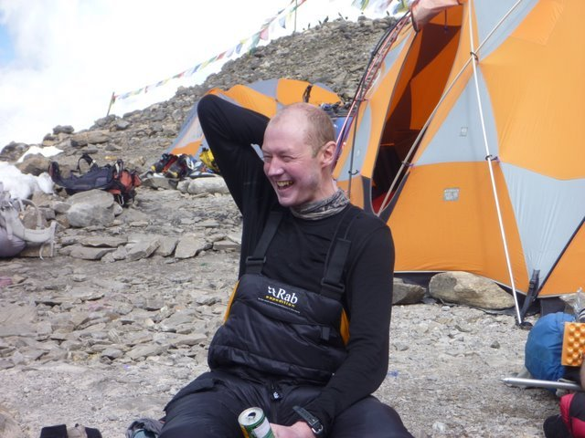 Here I am cheerful and relieved back at base camp, but clutching my neck which was in a great deal of pain by then (Photo: José Ferro)