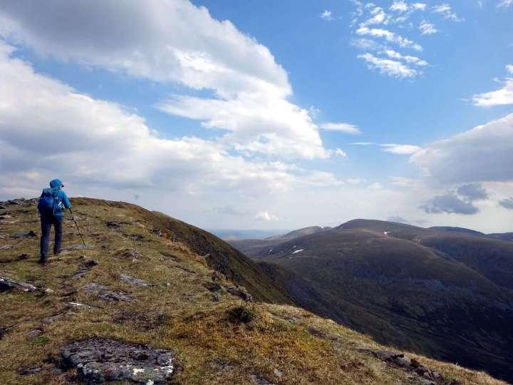 Approaching the north summit of Beinn a'Chaorainn with Creag Meagaidh in the distance