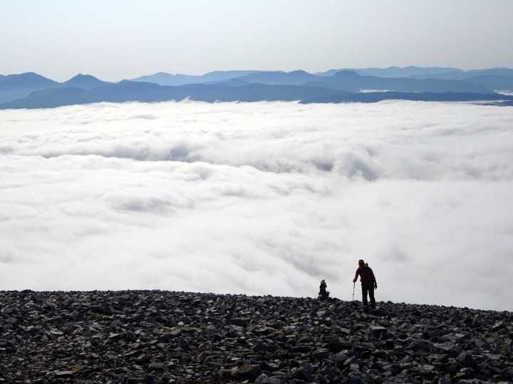Ascending above the clouds on Beinn Liath Mhor, with the southern peaks of Glen Carron behind
