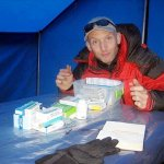 Jeremy examines medical supplies in the mess tent on Mera Peak (Photo: Jeremy Windsor)