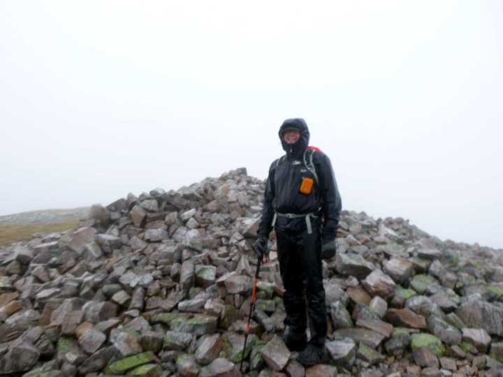 The summit of Stob Choire Claurigh (1,177m), the highest point in the Grey Corries, is no place for fools on a rainy day, yet here is one with a silly orange camera