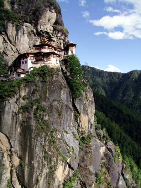 Taktshang Gompa (The Tiger's Nest) high on a cliff face above forest