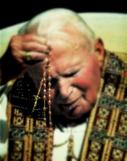 Pope John Paul II prays the rosary Oct. 7 at the Sanctuary of the Blessed Virgin Mary of the Holy Rosary in the center of Pompeii, Italy. The pontiff ended a year dedicated to the rosary, praying the five mysteries of light that he added to the rosary in October 2002. (CNS photo from Reuters) (Oct. 8, 2003) See POPE-POMPEII Oct. 7, 2003.