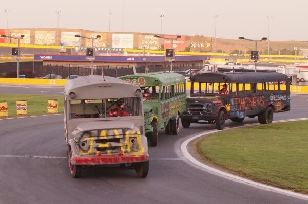 The Independent Tribune bus enters Turn 4 trying to hang on to second in the Bojangles' Summer Shootout at Charlotte Motor Speedway. CMS/John Davison