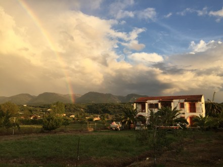 One idyllic evening in the north of the island, the sunset coincided with a patch of rain, leading to the most spectacular rainbow over our little Airbnb