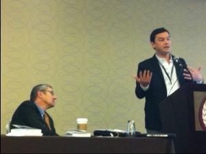 Harvard's Greg Mankiw listens to French economist Thomas Piketty.