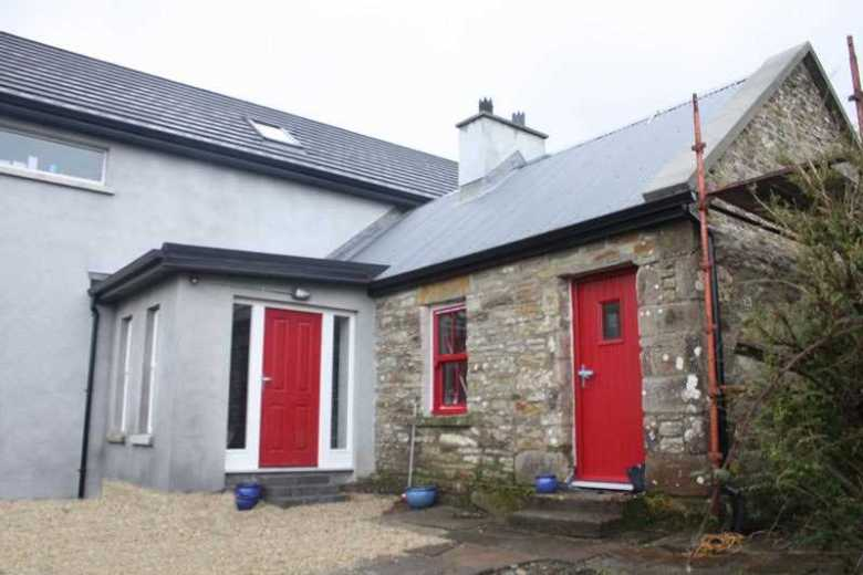 An extension and restoration of a small Irish cottage