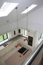 View down from mezzanine to kitchen