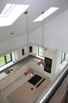 View down from mezzanine to kitchen