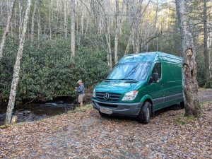 van by the river with jeremy fishing