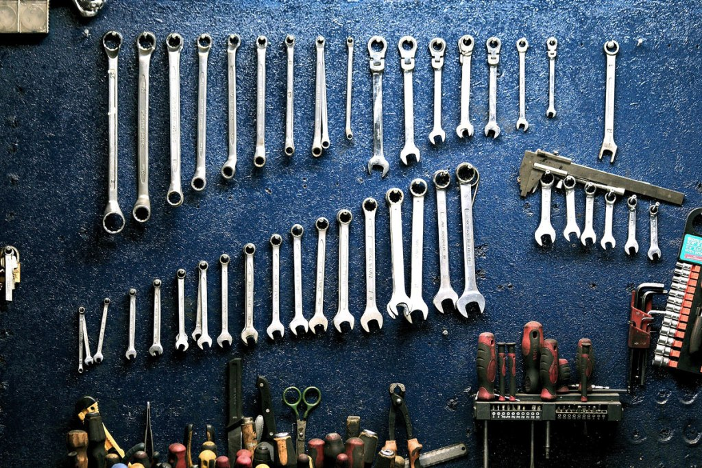 mechanic tools hanging on the wall