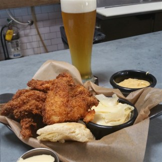 Tampa Bay Travel Guide featuring fried chicken and a beer at Urban Comfort Brewery in St. Petersburg
