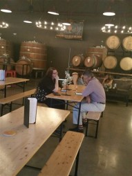 A couple drinking a flight of beers at 7venth Sun Brewery in Tampa, Florida