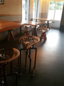 Tables with tractor seats as chairs at Angry Chair Brewing Company in Tampa.