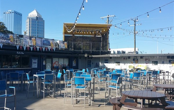 Outdoor patio and music stage at Ferg's Live in downtown Tampa near Amalie Arena
