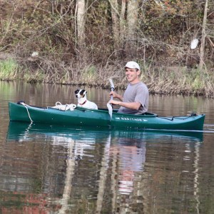 mark in kayak with dog