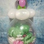 Geschenkballon mit Glückskäfer und Kleeblatt.
