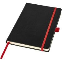 Röd anteckningsbok med gravyr