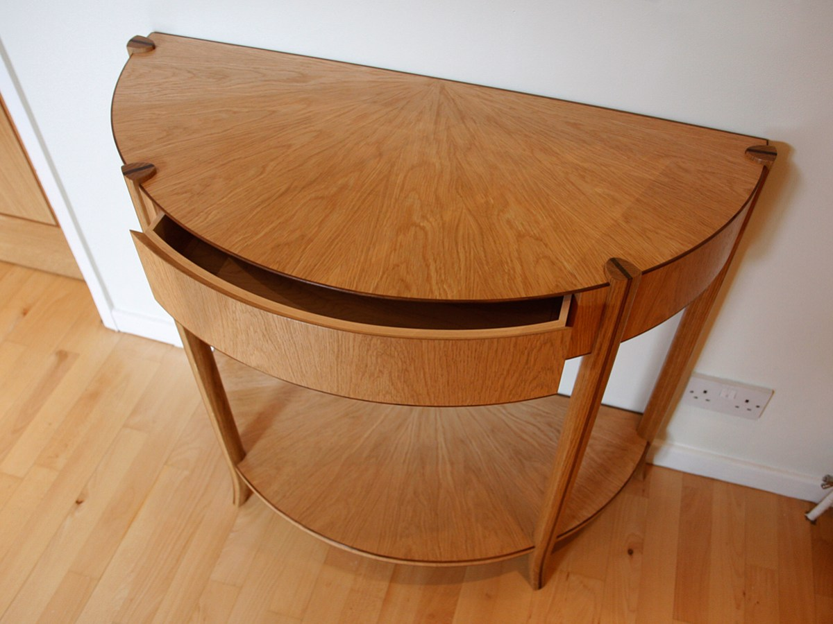 bespoke half elliptical freestanding tables in oak and walnut