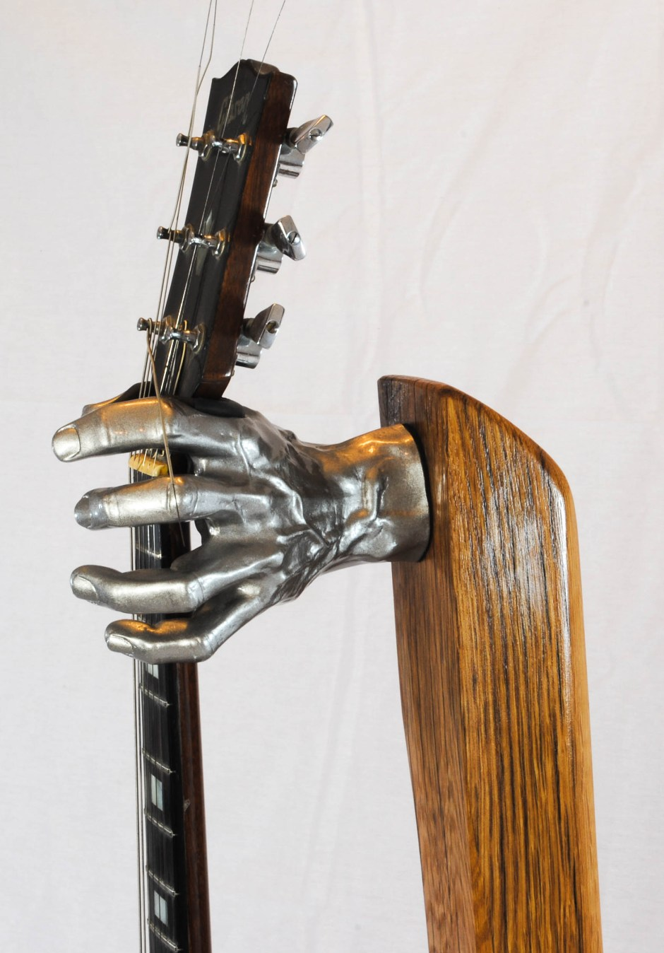 custom electric guitar, shot of creepy silver hand