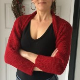 The happy knitter and her simple knit shrug.
