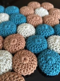 close up of crochet bottle caps