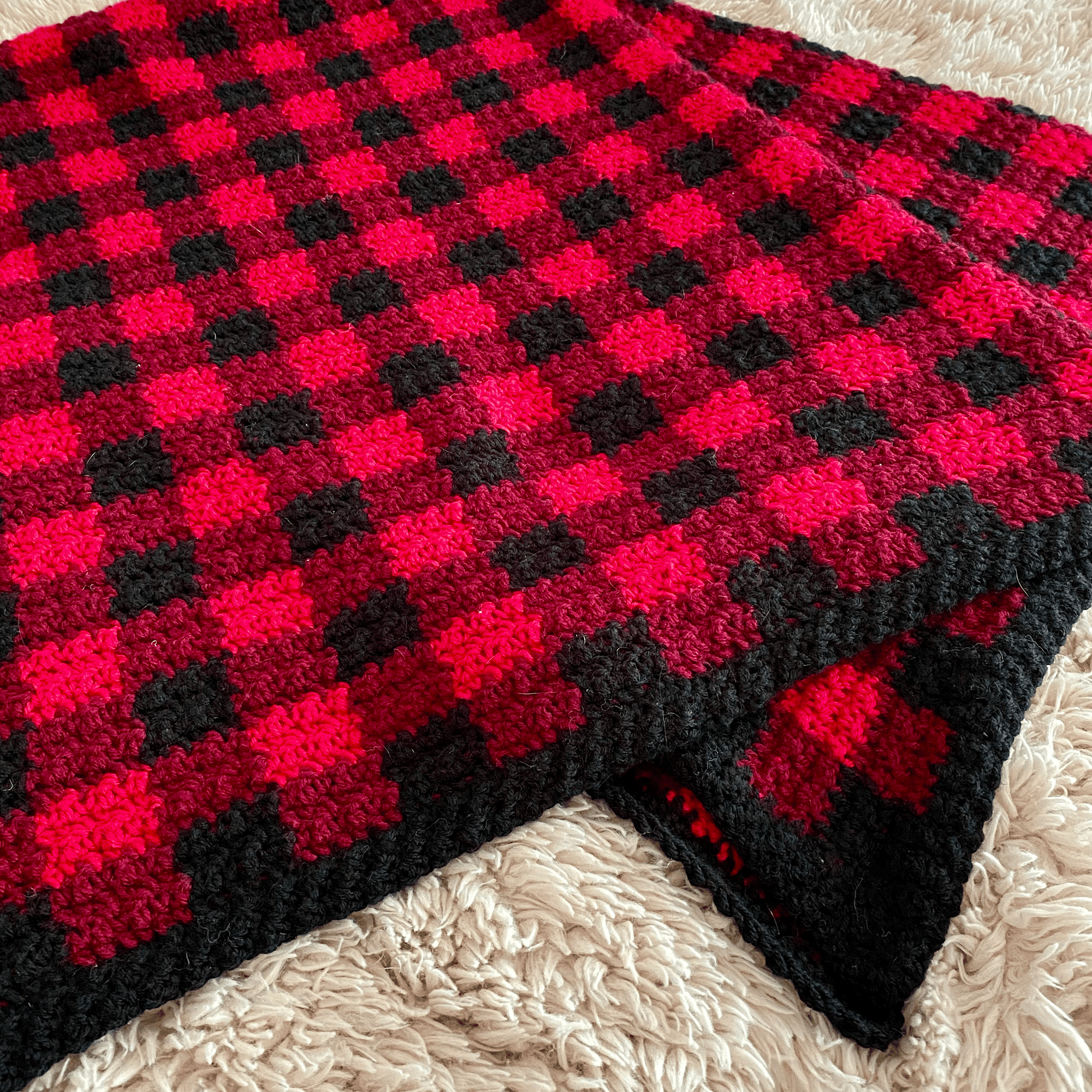 A cozy buffalo plaid or gingham crocheted afghan