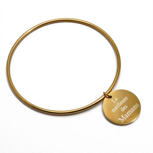 Bracelet jonc gravé en acier inoxydable doré.