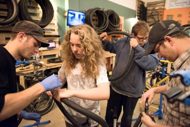 kids learning at the revolutions bike shop classes photo