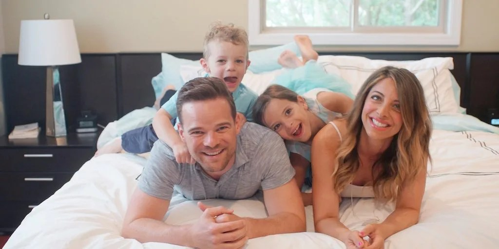 Andy, Nicole and the Hill Family on the bed