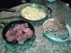 Silver dollar strawberry pancakes, maple turkey bacon, and scrambled eggs with herbs from the garden and cheddar cheese.