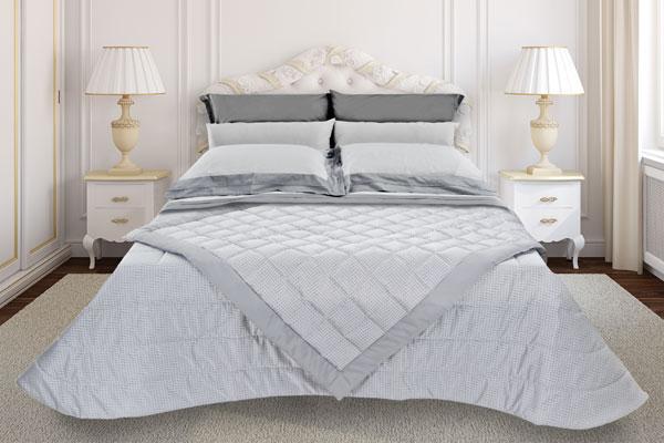 coordinato-letto-trapunta-trapuntino-scaldotto-lenzuola-grigio-ramage-600x400